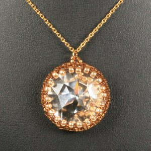 Swarovski rivoli pendant with seed beads