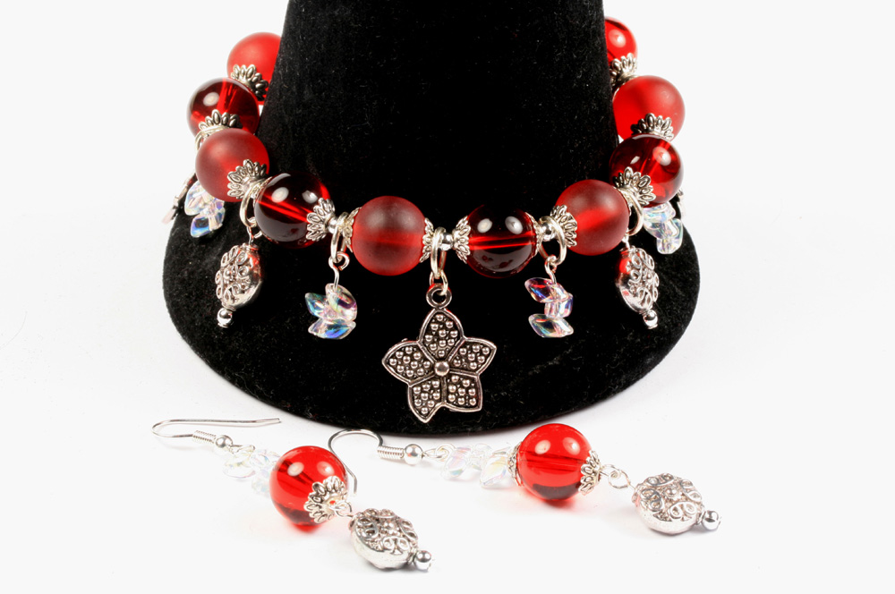 Strung charm bracelet with dangles
